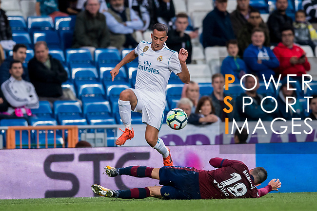 Lucas Vazquez (l) of Real Madrid jumps to avoid Anaitz Arbilla Zabala of SD Eibar during the La Liga 2017-18 match between Real Madrid and SD Eibar at Estadio Santiago Bernabeu on 22 October 2017 in Madrid, Spain. Photo by Diego Gonzalez / Power Sport Images
