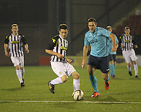 Lewis Morgan gets away from Stephen Husband in the St Mirren v Dunfermline Athletic Scottish Professional Football League Under 20 match played at the Excelsior Stadium, Airdrie on 11.12.13.