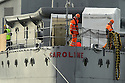 BELFAST, NORTHERN IRELAND :World War One Battle of Jutland veteran light cruiser, the 3,700-ton HMS Caroline is  moved from its current location in Alexandra Dock to Harland and Wolff Heavy Industries' Belfast Dock for a scheduled hull inspection and repair, Friday, October 28, 2016. Two tug boats towed the ship from its moorings to the Belfast Dock at the mouth of the harbour. This is her first docking for almost three decades and a maritime event to be matched only by her return journey anticipated to be before Christmas. -HMS Caroline is now a proud monument to the 10,000 Irishmen who lost their lives at sea between 1914 and 1918. The £15m restoration project was funded by the Heritage Lottery Fund with support from Department for the Economy and Tourism Northern Ireland. Photo/Paul McErlane