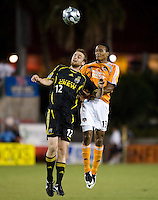 Columbus Crew midfielder Eddie Gaven (12) and Houston Dynamo midfielder Ricardo Clark (13) go up for the header. The Houston Dynamo tied the Columbus Crew 1-1 in a regular season MLS match at Robertson Stadium in Houston, TX on August 25, 2007.