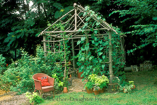 Garden Shed Made Of Saplings Used As Trellis
