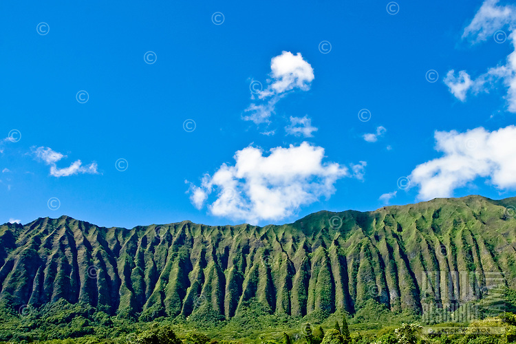 Panoramic Koolau Mountains against bright blue sky