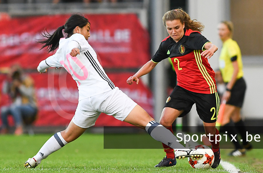 20170613 - LEUVEN ,  BELGIUM : Belgian Davina Philtjens (r) pictured avoiding the tackle from Japanese Ayumi Oya (left) during the friendly female soccer game between the Belgian Red Flames and JAPAN , a friendly game in the preparation for the European Championship in The Netherlands 2017  , Tuesday 13 th June 2017 at Stadion Den Dreef  in Leuven , Belgium. PHOTO SPORTPIX.BE | DAVID CATRY