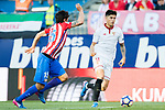 Carlos Joaquin Correa (r) of Sevilla FC is challenged by Stefan Savic of Atletico de Madrid during their La Liga match between Atletico de Madrid and Sevilla FC at the Estadio Vicente Calderon on 19 March 2017 in Madrid, Spain. Photo by Diego Gonzalez Souto / Power Sport Images
