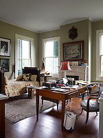 The home office furnished with an antique day bed and desk