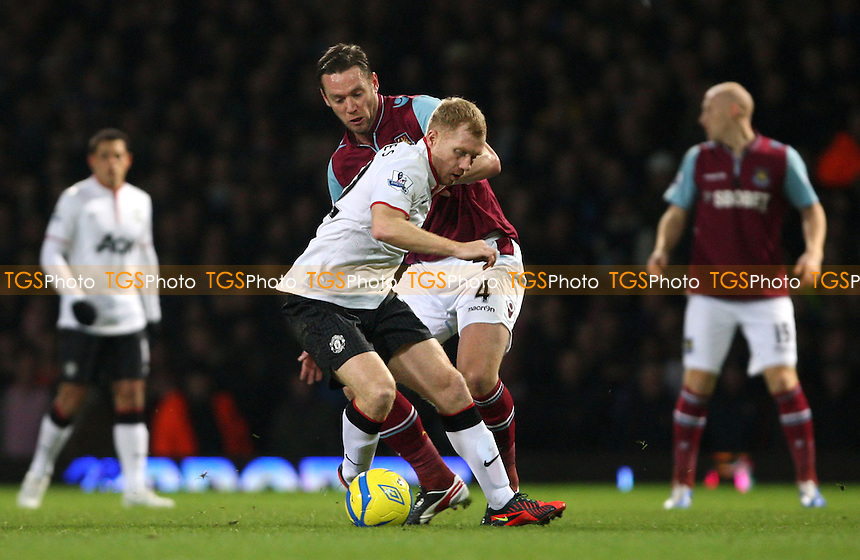 Paul Scholes of Manchester United and Kevin Nolan of West Ham - West Ham United vs Manchester United, FA Cup 3rd round at Upton Park, West Ham - 05/01/13 - MANDATORY CREDIT: Rob Newell/TGSPHOTO - Self billing applies where appropriate - 0845 094 6026 - contact@tgsphoto.co.uk - NO UNPAID USE.