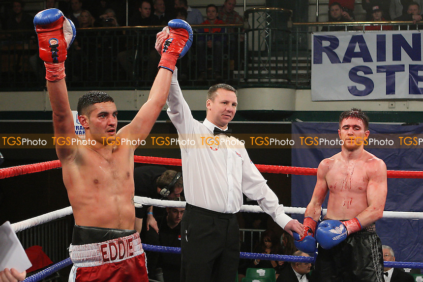 Ediz Hussein (claret/blue shorts) defeats Marc Callaghan in a Lightweight boxing contest at York Hall, Bethnal Green, promoted by Frank Warren - 10/02/12 - MANDATORY CREDIT: Gavin Ellis/TGSPHOTO - Self billing applies where appropriate - 0845 094 6026 - contact@tgsphoto.co.uk - NO UNPAID USE.