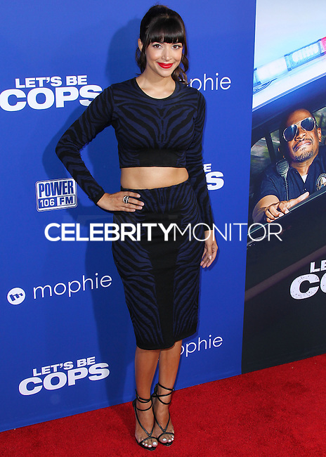 HOLLYWOOD, LOS ANGELES, CA, USA - AUGUST 07: Actress Hannah Simone arrives at the Los Angeles Premiere Of 20th Century Fox's 'Let's Be Cops' held at ArcLight Cinemas Cinerama Dome on August 7, 2014 in Hollywood, Los Angeles, California, United States. (Photo by Xavier Collin/Celebrity Monitor)