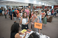Evie Wasson '21 and Renya Wasson chat at the Academic Department Information Fair in the Academic Commons. Incoming first-years and their families are welcomed by O-Team members and the community at the start of Occidental College's Fall Orientation for the class of 2021, Aug. 24, 2017.<br /> (Photo by Marc Campos, Occidental College Photographer)