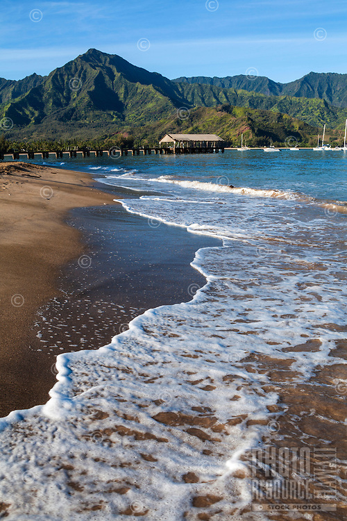 Hanalei Beach on a beautiful day, with Hanalei Pier in the distance, Hanalei Bay, Kaua'i.