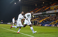 Adebayo Akinfenwa of Wycombe Wanderers celebrates his winning goal with Myles Weston of Wycombe Wanderers during the The Checkatrade Trophy  Quarter Final match between Mansfield Town and Wycombe Wanderers at the One Call Stadium, Mansfield, England on 24 January 2017. Photo by Andy Rowland.