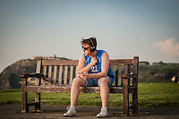 UK Weather: Aberystwyth, Ceredigion, West Wales <br />A young man enjoys his music during the early evening.