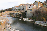 The old stone bridge across the Orbieu river in the village Ribaute. Les Corbieres. Languedoc. France. Europe.