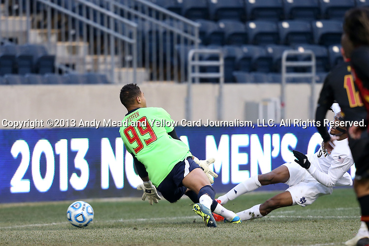 15 December 2013: Notre Dame's Leon Brown (9) scores the first half equalizer past Maryland's Zack Steffen (99). The University of Maryland Terripans played the University of Notre Dame Fighting Irish at PPL Park in Chester, Pennsylvania in a 2013 NCAA Division I Men's College Cup championship match.