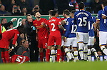 Jordan Henderson of Liverpool lies injured as Adam Lallana of Liverpool and Seamus Coleman of Everton clash during the English Premier League match at Goodison Park, Liverpool. Picture date: December 19th, 2016. Photo credit should read: Lynne Cameron/Sportimage
