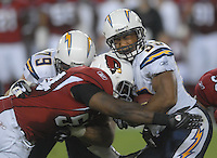 Aug 25, 2007; Glendale, AZ, USA; Arizona Cardinals linebacker Gerald Hayes (54) tackles San Diego Chargers running back Michael Turner (33) at University of Phoenix Stadium. San Diego defeated Arizona 33-31. Mandatory Credit: Mark J. Rebilas-US PRESSWIRE