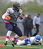 Plainview JFK quarterback No. 7 Kevin Pastier runs the ball on a keep in the second quarter of a Nassau County Conference I varsity football game against Port Washington at Plainview JFK High School on Saturday, October 3, 2015. Plainview JFK won by a score of 42-0.<br /> <br /> James Escher