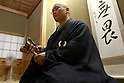 July 20, 2010 - Niiza, Japan - A Japanese Zen monk explains how to practice Zazen, a meditative discipline practitioners perform to calm the body and the mind, at Heirin-ji, a Rinzai temple of the Myoshin-ji branch located in Niiza city, Saitama prefecture, Japan, on July 20, 2010. The activity is part of the 'True Japan Saitama - Zen Medidation and Buddhist Vegetarian Cuisine' tour, organized by the travel agency JTB for leisure travelers.