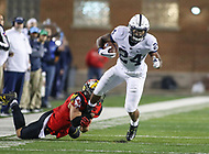College Park, MD - November 25, 2017: Penn State Nittany Lions running back Miles Sanders (24) tries to break a tackle during game between Penn St and Maryland at  Capital One Field at Maryland Stadium in College Park, MD.  (Photo by Elliott Brown/Media Images International)