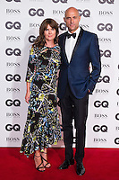 (L-R) Liza Marshall and Mark Strong arrive for the GQ Men Of The Year Awards 2016 at the Tate Modern, London