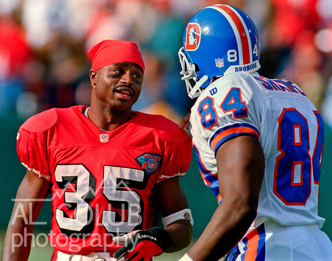 San Francisco 49ers vs. Denver Broncos at Candlestick Park Saturday, December 17, 1994.  49ers beat Broncos 42-19.  San Francisco 49ers running back Dexter Carter (35) and Denver Broncos tight end Shannon Sharpe (84) exchange comments.