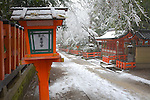 Kyoto City, Japan<br /> Yasaka Shrine, Gion district, snowy pathway in falling snow