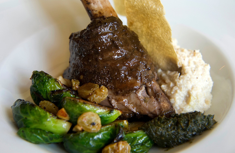UNITED STATES - AUGUST 1: Unum Chef Phillip Blane's braised Indian spiced lamb shank with raisin-cashew cauliflower, brussels sprouts, and cilantro-mint chutney. (Photo By Chris Maddaloni/CQ Roll Call)