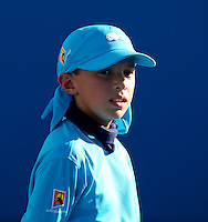Ball Kid on Rod Laver Arena on Day One of the Australian Open..16/01/2012, 16th January 2012, 16.01.2012..The Australian Open, Melbourne Park, Melbourne,Victoria, Australia.@AMN IMAGES, Frey, Advantage Media Network, 30, Cleveland Street, London, W1T 4JD .Tel - +44 208 947 0100..email - mfrey@advantagemedianet.com..www.amnimages.photoshelter.com.
