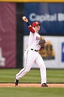 Harrisburg Senators second baseman Rick Hague (5) warmup throw to first during a game against the New Britain Rock Cats on April 28, 2014 at Metro Bank Park in Harrisburg, Pennsylvania.  Harrisburg defeated New Britain 9-0.  (Mike Janes/Four Seam Images)