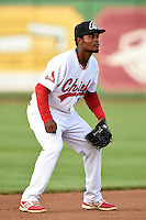 Peoria Chiefs shortstop Juan Herrera (12) during a game against the Kane County Cougars on June 2, 2014 at Dozer Park in Peoria, Illinois.  Peoria defeated Kane County 5-3.  (Mike Janes/Four Seam Images)
