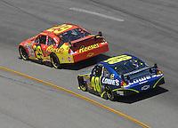 May 6, 2007; Richmond, VA, USA; Nascar Nextel Cup Series driver Kevin Harvick (29) leads Jimmie Johnson (48) during the Jim Stewart 400 at Richmond International Raceway. Mandatory Credit: Mark J. Rebilas