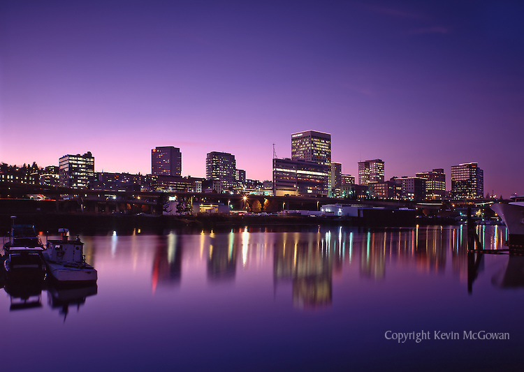 Tacoma Skyline reflected in Thea Foss Waterway at sunset