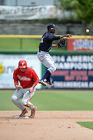New York Yankees shortstop Jorge Mateo (11) throws to first after forcing out Damek Tomscha at second during an Instructional League game against the Philadelphia Phillies on September 23, 2014 at the Bright House Field in Clearwater, Florida.  (Mike Janes/Four Seam Images)