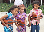 The Suzuki violinists prepare to go on at the Dragon and Phoenix Spark Park dedication ceremony at Mandarin Immersion Magnet School on Oct. 27, 2017.
