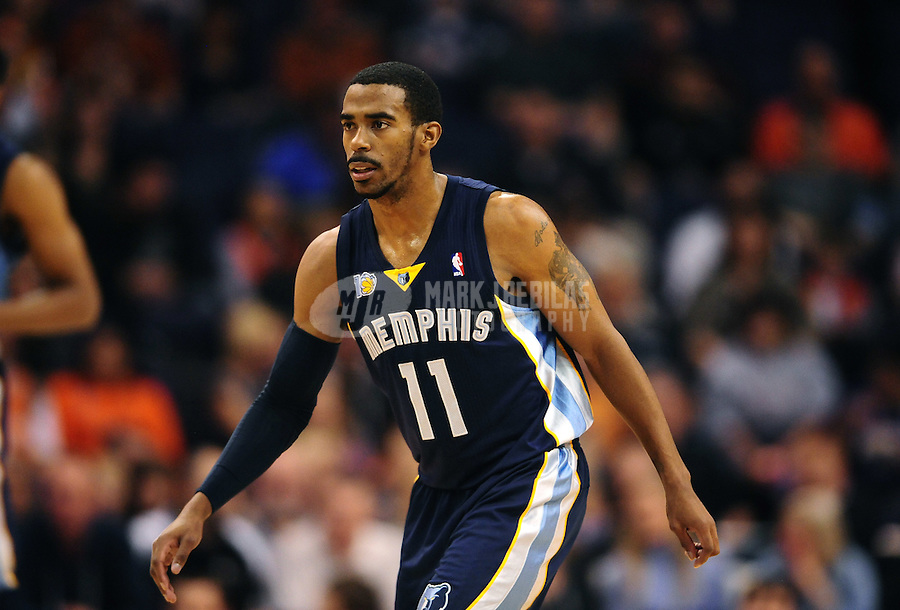 Dec. 8, 2010; Phoenix, AZ, USA; Memphis Grizzlies guard (11) Mike Conley against the Phoenix Suns at the US Airways Center. Memphis defeated Phoenix 104-98 in overtime. Mandatory Credit: Mark J. Rebilas-