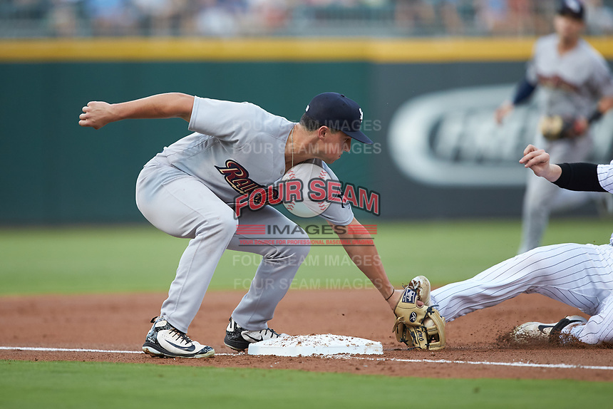 Scranton/Wilkes-Barre RailRiders third baseman Mandy Alvarez (24) applies a tag to Zack Collins (8) of the Charlotte Knights as he slides into third base at BB&T BallPark on August 13, 2019 in Charlotte, North Carolina. The Knights defeated the RailRiders 15-1. (Brian Westerholt/Four Seam Images)