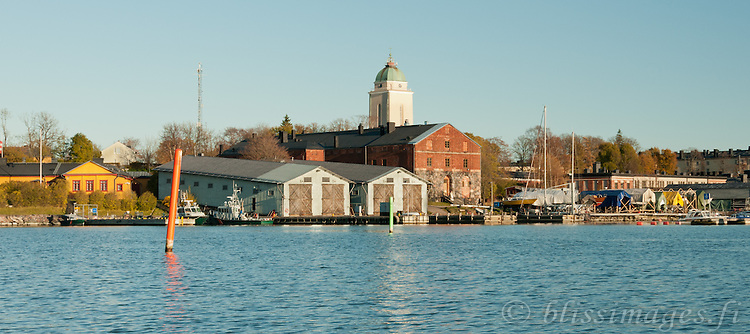 Suomenlinna Church Lighthouse and its dockyards in late autumn -Helsinki, Finland.
