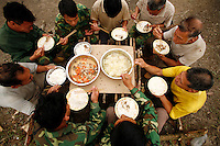 Contract workers during lunch break in their camp on Stora Enso land near Beihai, Guangxi Province, China..12 Apr 2007