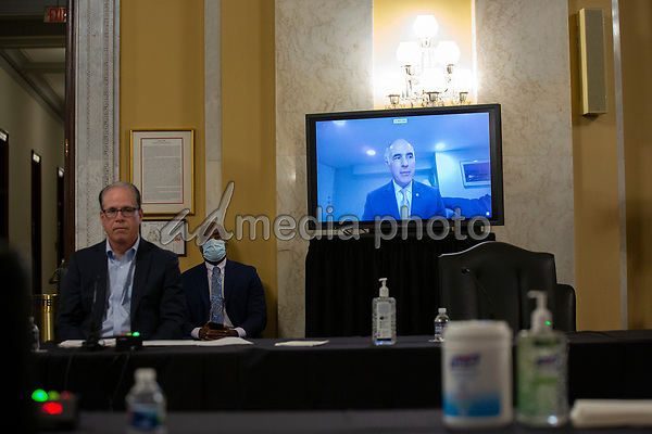 United States Senator Bob Casey, Jr. (Democrat of Pennsylvania), right, speaks via video call during a United States Senate Aging Committee hearing at the United States Capitol in Washington D.C., U.S. on Thursday, May 21, 2020.  Credit: Stefani Reynolds / CNP/AdMedia
