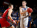 BROOKINGS, SD - DECEMBER 31:  A.J. Hess #35 from South Dakota State University looks for a teammate past Matt Mooney #13 from the University of South Dakota during their game Saturday afternoon at Frost Arena in Brookings. (Dave Eggen/Inertia)