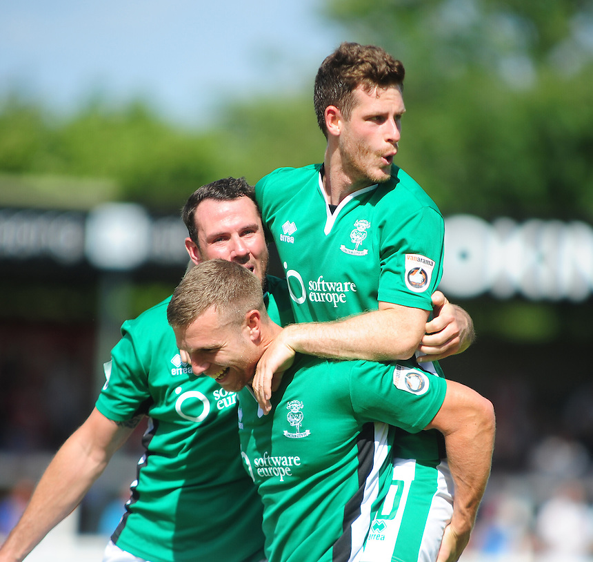 Lincoln City's Adam Marriott, centre, celebrates scoring his sides first goal <br /> <br /> Photographer Andrew Vaughan/CameraSport<br /> <br /> Football - Vanarama National League - Woking v Lincoln City - Saturday 6th August 2016 - The Kingfield Stadium - Woking<br /> <br /> &copy; CameraSport - 43 Linden Ave. Countesthorpe. Leicester. England. LE8 5PG - Tel: +44 (0) 116 277 4147 - admin@camerasport.com - www.camerasport.com