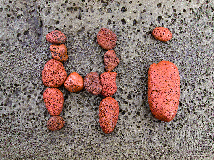 """Hi"" written with red stones found along the rocky beach of Pololu Valley, Hawi, Big Island."