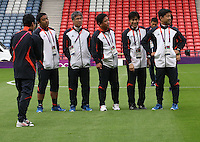 Hampden Park, Glasgow match venue for Football at London 2012...Japanese coaches inspecting the pitch........