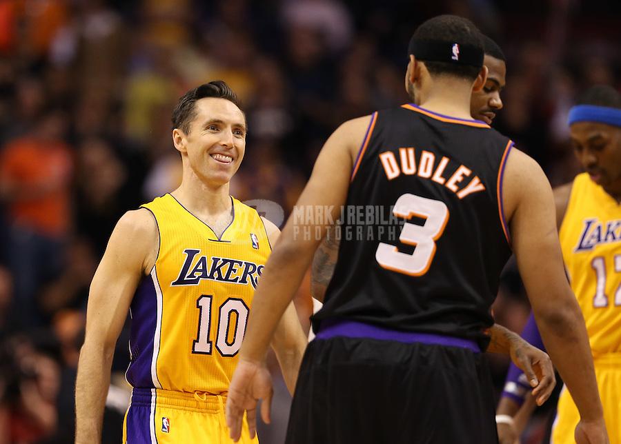 Jan. 30, 2013; Phoenix, AZ, USA: Los Angeles Lakers guard Steve Nash (10) greets Phoenix Suns forward Jared Dudley at the US Airways Center. Mandatory Credit: Mark J. Rebilas-