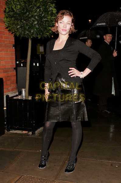 CAMILLA RUTHERFORD.The Chanel pre Autumn / Winter Collection Show at Phillips de Pury & Co, Victoria, London, England. .December 6th, 2007 .full length black leather jacket top cardigan hand on hip tights strappy shoes .CAP/AH.©Adam Houghton/Capital Pictures.