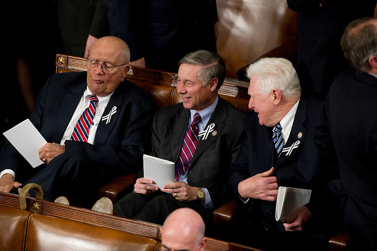 WASHINGTON, DC- Jan. 25: Rep. John D. Dingell, D-Mich., House Energy Chairman Fred Upton, R-Mich., and Rep. James P. Moran, D-Va., wait for President Barack Obama's State of the Union address to a joint session of the U.S. Congress. In the wake of the Jan. 8 shootings in Tucson, Ariz., that wounded Rep. Gabrielle Giffords (D-Ariz.), there has been a push for lawmakers to break from the tradition of partisan seating at the State of Union address. (Photo by Scott J. Ferrell/Congressional Quarterly)