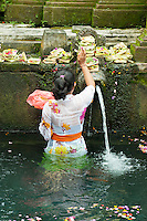 Making offerings at holy water temple, Tampak Siring, Bali