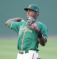 Outfielder Marcel Ozuna (34) of the Greensboro Grasshoppers, Class A affiliate of the Florida Marlins, prior to a game against the Greenville Drive on April 26, 2011, at Fluor Field at the West End in Greenville, South Carolina. (Tom Priddy/Four Seam Images)