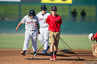 Kannapolis Intimidators grounds crew member Allan Westerholt drags the infield between innings of the game against the Delmarva Shorebirds at Kannapolis Intimidators Stadium on July 2, 2017 in Kannapolis, North Carolina.  The Shorebirds defeated the Intimidators 5-4.  (Brian Westerholt/Four Seam Images)