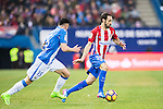 Juan Francisco Torres Belen, Juanfran (r), of Atletico de Madrid competes for the ball with Diego Rico of Deportivo Leganes during their La Liga match between Atletico de Madrid and Deportivo Leganes at the Vicente Calderón Stadium on 04 February 2017 in Madrid, Spain. Photo by Diego Gonzalez Souto / Power Sport Images